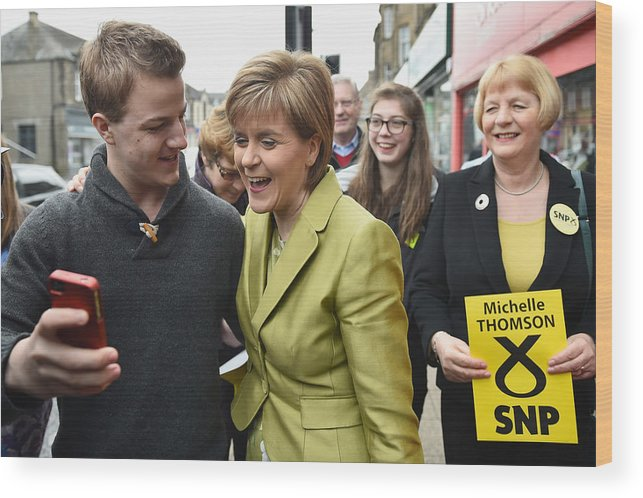 Democracy Wood Print featuring the photograph SNP Leader Nicola Sturgeon Unveils An Anti-Austerity Plan To Boost the NHS by Jeff J Mitchell