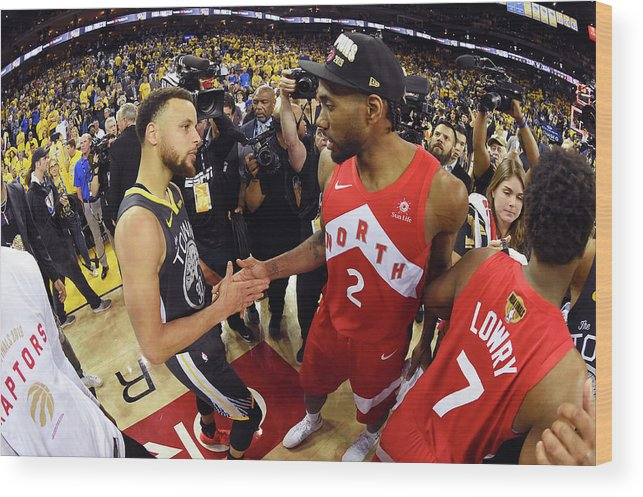 Playoffs Wood Print featuring the photograph Stephen Curry and Kawhi Leonard by Andrew D. Bernstein