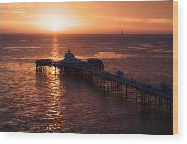 Piers Wood Print featuring the photograph Sunrise over Llandudno pier 2 by Christopher Rowlands
