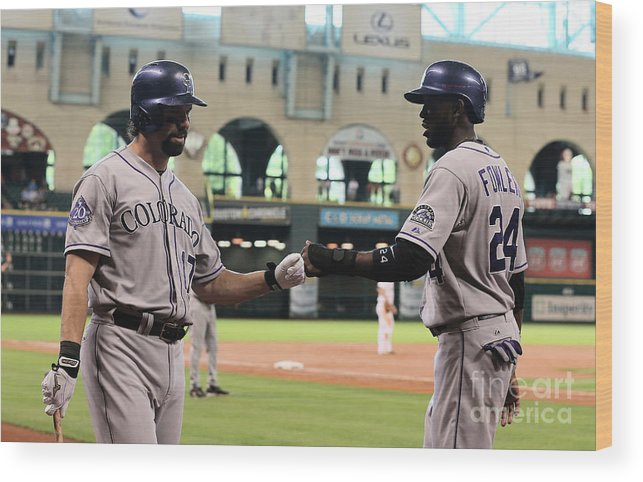 American League Baseball Wood Print featuring the photograph Todd Helton and Dexter Fowler by Scott Halleran