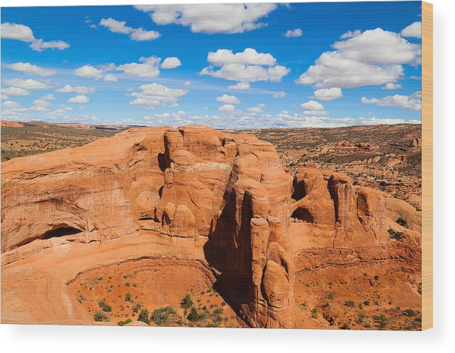 Tranquility Wood Print featuring the photograph View Of Rock Formations Against Cloudy Sky by Alberto Zanoni / EyeEm