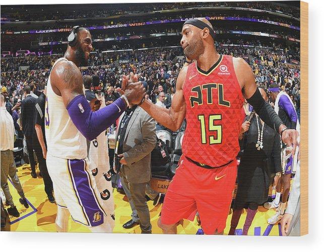 Nba Pro Basketball Wood Print featuring the photograph Vince Carter and Lebron James by Andrew D. Bernstein