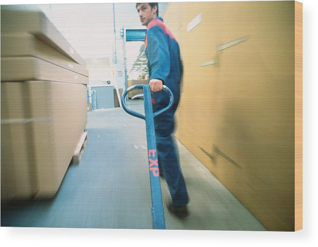 Working Wood Print featuring the photograph Warehouse worker by James Hardy