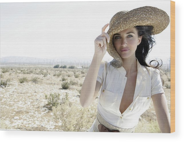 Wind Wood Print featuring the photograph Woman outdoors holding large hat by Eye Candy Images
