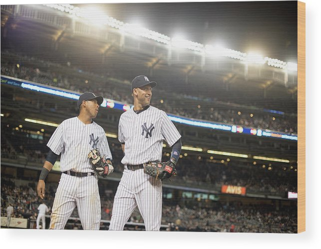American League Baseball Wood Print featuring the photograph Yangervis Solarte and Derek Jeter by Rob Tringali