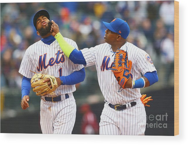 Yoenis Cespedes Wood Print featuring the photograph Yoenis Cespedes and Amed Rosario by Mike Stobe