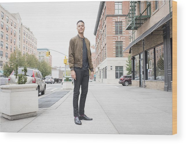 People Wood Print featuring the photograph Young man standing on city sidewalk by Tony Anderson
