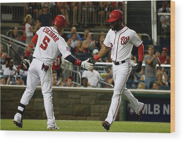 People Wood Print featuring the photograph Yunel Escobar and Denard Span by Rob Carr
