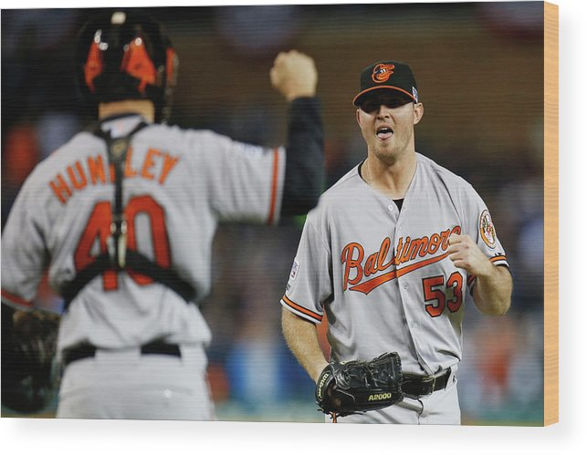 American League Baseball Wood Print featuring the photograph Zach Britton and Nick Hundley by Gregory Shamus