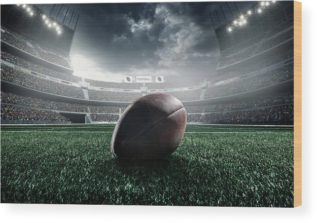 Event Wood Print featuring the photograph American Football Ball by Dmytro Aksonov