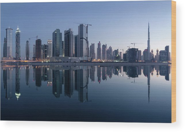 Tranquility Wood Print featuring the photograph Dubai Business Bay Skyline With by Spreephoto.de