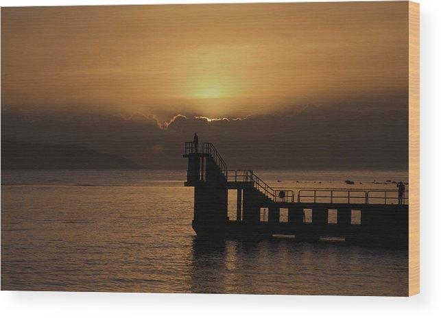 #galwaybay #galway #theprom #blackrock #salthill #ireland #travel #sunset #wildatlanticway #seascape #tourism #failteireland #sea #aranislands #silhouette #sun #irish #galwaygirl #tourism #landmark #divingboard #sundown Wood Print featuring the photograph Sunset on Galway Bay by Rachel Dubber
