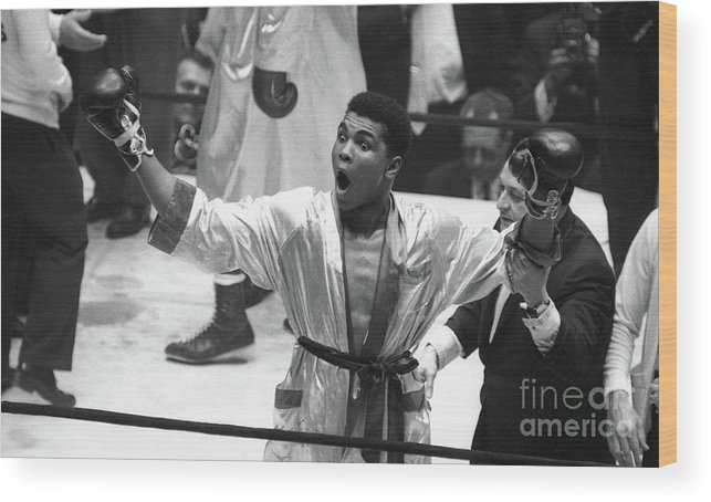 Heavyweight Wood Print featuring the photograph Cassius Clay Vs Doug Jones by The Stanley Weston Archive
