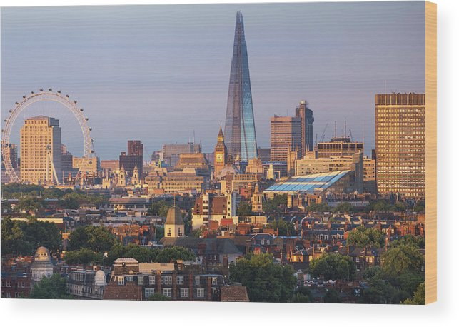 Tranquility Wood Print featuring the photograph City Skyline In Late Evening Sunlight by Simon Butterworth
