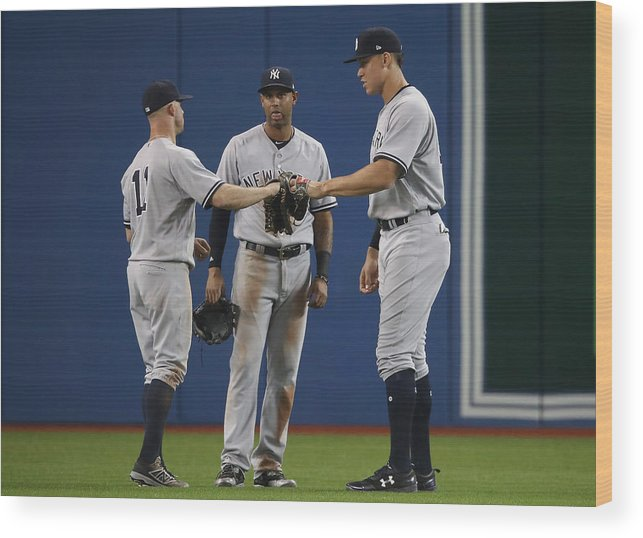 People Wood Print featuring the photograph New York Yankees v Toronto Blue Jays by Tom Szczerbowski