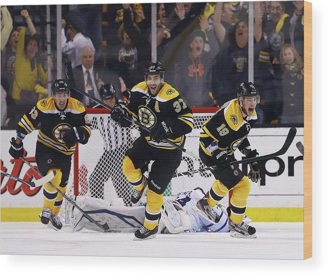 Following Wood Print featuring the photograph Toronto Maple Leafs V Boston Bruins - by Jared Wickerham