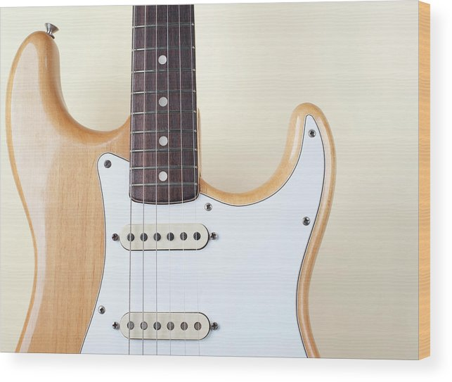 Rock Music Wood Print featuring the photograph Beige Wood Textured Electric Guitar by Neyya