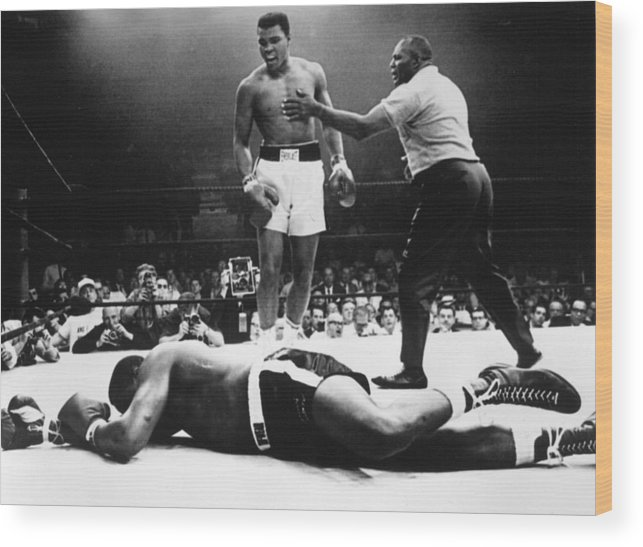 Heavyweight Wood Print featuring the photograph Clay V Liston by Hulton Archive