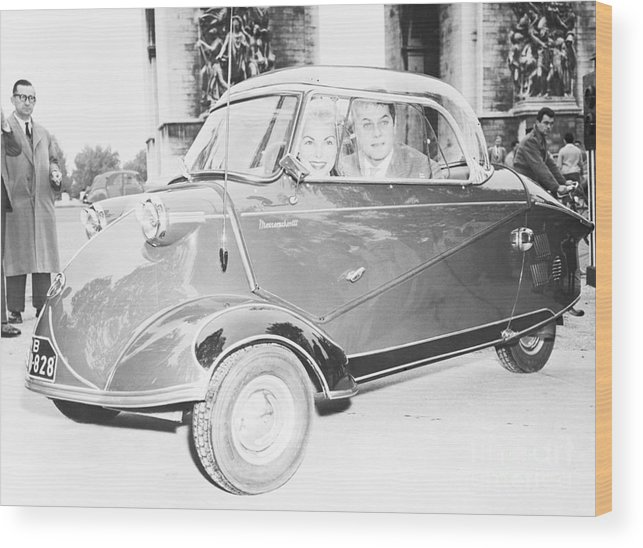 People Wood Print featuring the photograph Janet Leigh And Tony Curtis In Minicar by Bettmann