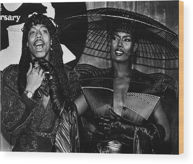 Singer Wood Print featuring the photograph Rick James And Grace Jones Attend by George Rose