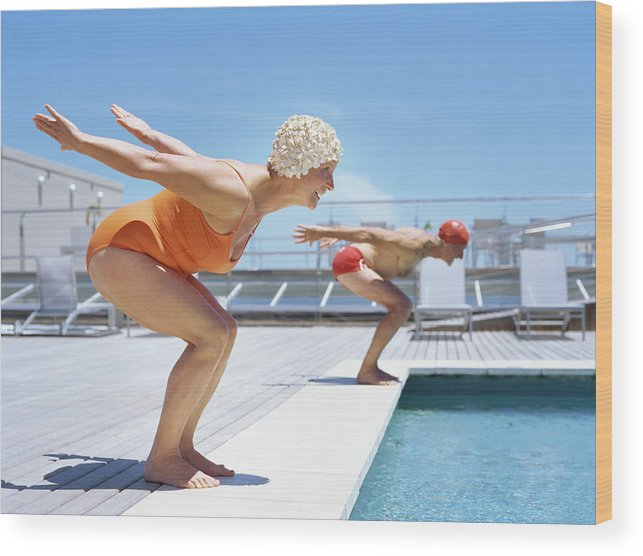 Diving Into Water Wood Print featuring the photograph Senior Couple Ready To Dive In To by Stockbyte