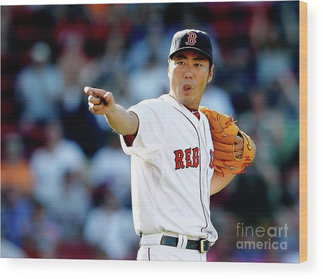 American League Baseball Wood Print featuring the photograph Koji Uehara by Jim Rogash