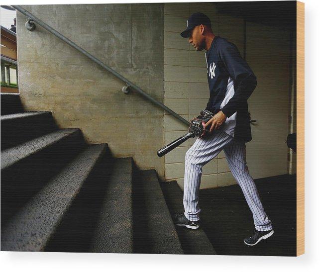Derek Jeter Wood Print featuring the photograph Derek Jeter by Al Bello
