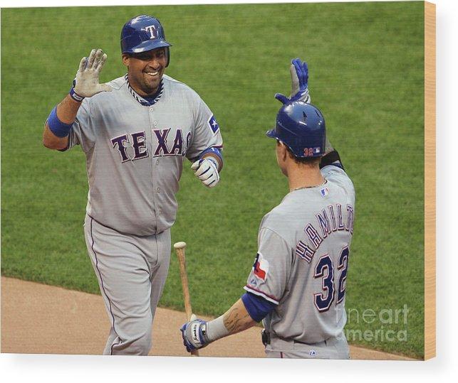American League Baseball Wood Print featuring the photograph Bengie Molina and Josh Hamilton by Justin Sullivan