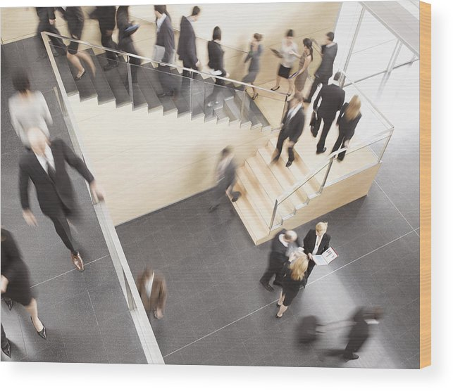 Young Men Wood Print featuring the photograph Businesspeople Walking In Busy Office Building by Robert Daly