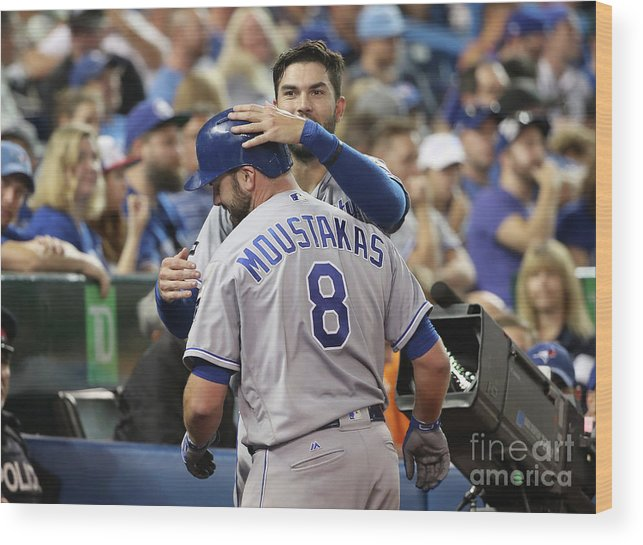 Three Quarter Length Wood Print featuring the photograph Mike Moustakas and Eric Hosmer by Tom Szczerbowski