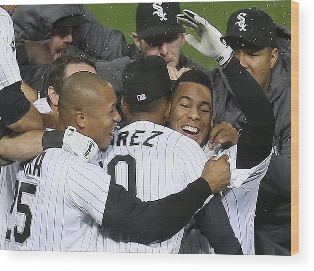 American League Baseball Wood Print featuring the photograph Moises Sierra and Alexei Ramirez by Jonathan Daniel