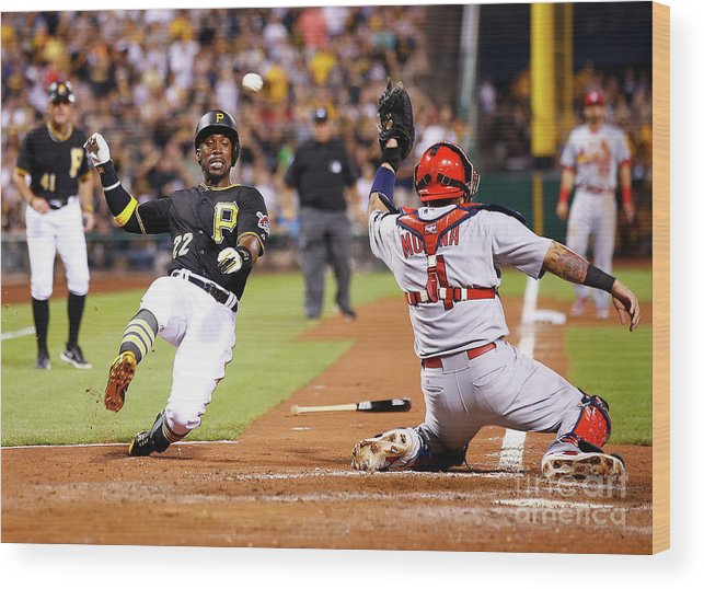 St. Louis Cardinals Wood Print featuring the photograph Yadier Molina and Andrew Mccutchen by Jared Wickerham
