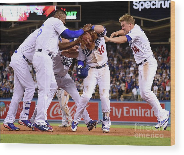 Ninth Inning Wood Print featuring the photograph Yasiel Puig and Justin Turner by Harry How