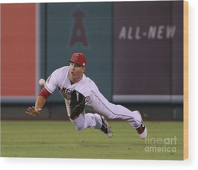 Yoenis Cespedes Wood Print featuring the photograph Yoenis Cespedes and Mike Trout by Jeff Gross