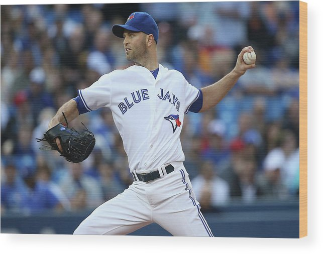 American League Baseball Wood Print featuring the photograph Kansas City Royals V Toronto Blue Jays by Tom Szczerbowski