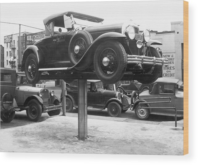 1920's Wood Print featuring the photograph Auto Repair Shop Lift by Underwood Archives