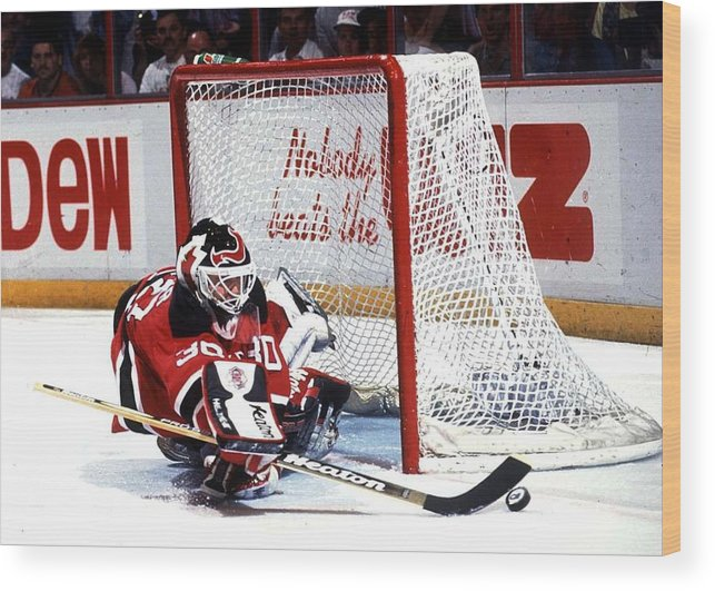 National Hockey League Wood Print featuring the photograph Brodeur stops Flyers by B Bennett