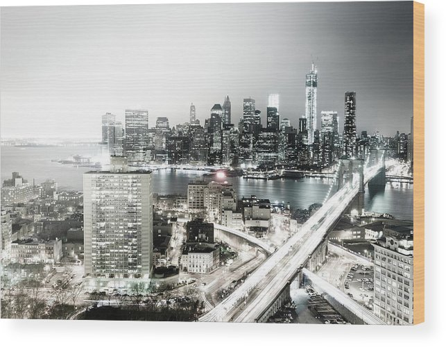 Lower Manhattan Wood Print featuring the photograph New York City Skyline At Night by Mundusimages