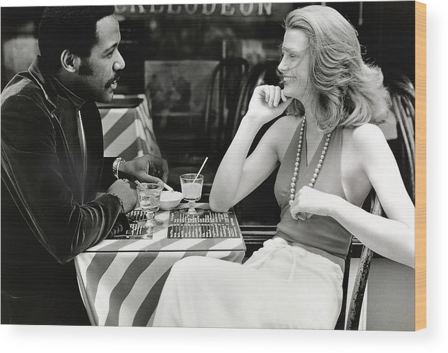 Actor Wood Print featuring the photograph Richard Roundtree And Model At Cafe by Rico Puhlmann