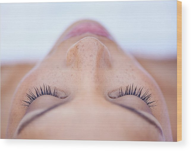 Eyelash Wood Print featuring the photograph She's in a deeply relaxed state of mind by PeopleImages