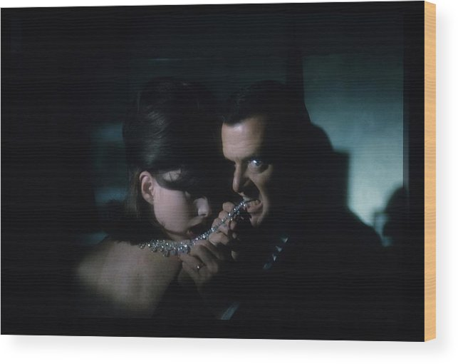 Actor Wood Print featuring the photograph Tony Randall Biting A Cartier Necklace by Sante Forlano