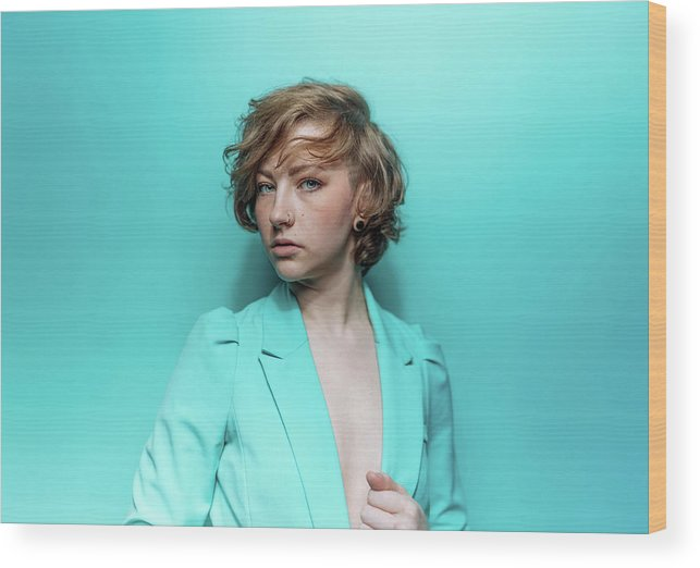 People Wood Print featuring the photograph Woman In Blue Jacket On Blue Background by Ian Ross Pettigrew