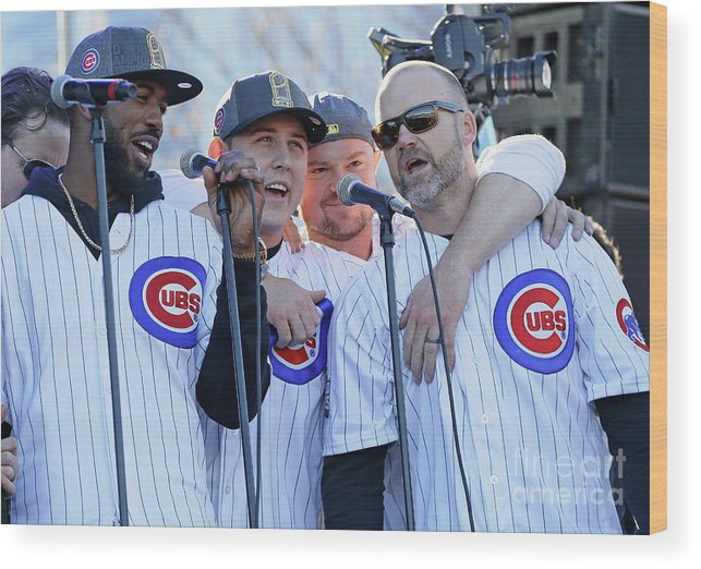 Three Quarter Length Wood Print featuring the photograph Chicago Cubs Victory Celebration by Jonathan Daniel