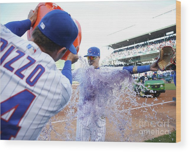 Following Wood Print featuring the photograph St Louis Cardinals V Chicago Cubs by Nuccio Dinuzzo