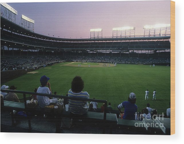 1980-1989 Wood Print featuring the photograph Philadelphia Phillies V Chicago Cubs by Jonathan Daniel