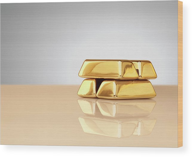 Four Objects Wood Print featuring the photograph A Stack Of Four Gold Ingots by Anthony Bradshaw