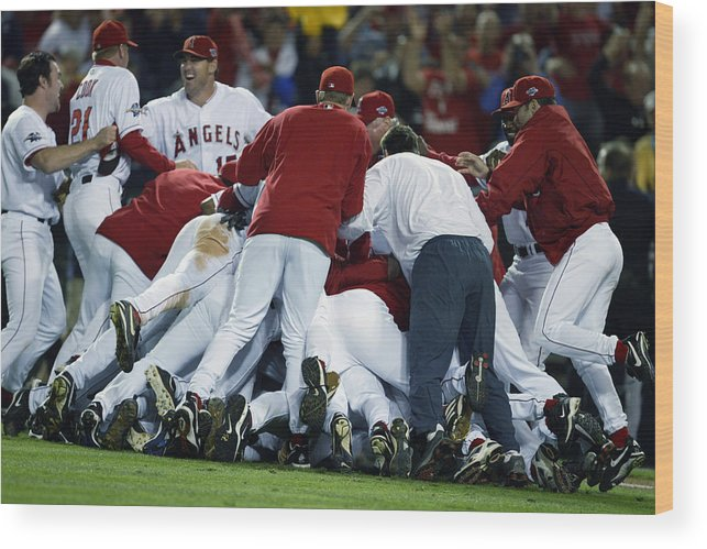 Los Angeles Angels Of Anaheim Wood Print featuring the photograph Angels Celebrate by Al Bello