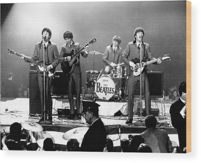 Rock Music Wood Print featuring the photograph Beatles Perform In Washington, D.c by Michael Ochs Archives