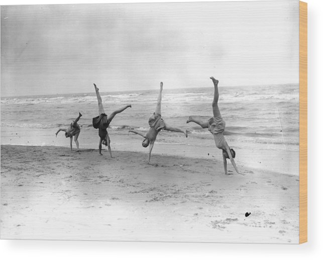 People Wood Print featuring the photograph Cartwheels by Fox Photos