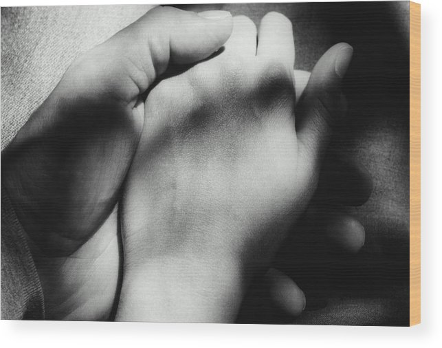 Young Men Wood Print featuring the photograph Couple Holding Hands, Close-up Of Hands by Martine Mouchy